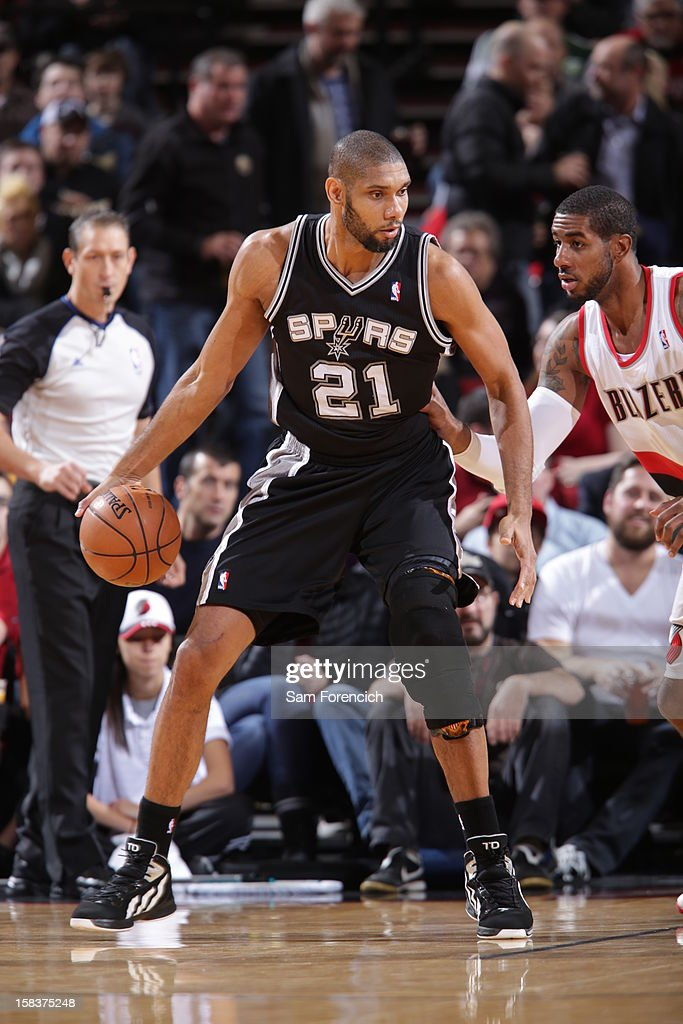<a gi-track='captionPersonalityLinkClicked' href=/galleries/search?phrase=Tim+Duncan&family=editorial&specificpeople=201467 ng-click='$event.stopPropagation()'>Tim Duncan</a> #21 of the San Antonio Spurs looks to drives to the basket while guarded by <a gi-track='captionPersonalityLinkClicked' href=/galleries/search?phrase=LaMarcus+Aldridge&family=editorial&specificpeople=453277 ng-click='$event.stopPropagation()'>LaMarcus Aldridge</a> #12 of the Portland Trail Blazers on December 13, 2012 at the Rose Garden Arena in Portland, Oregon.