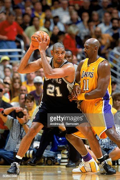 Tim Duncan of the San Antonio Spurs looks to make the pass against Karl Malone of the Los Angeles Lakers in Game Six of the Western Conference...