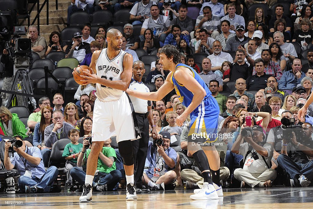 <a gi-track='captionPersonalityLinkClicked' href=/galleries/search?phrase=Tim+Duncan&family=editorial&specificpeople=201467 ng-click='$event.stopPropagation()'>Tim Duncan</a> #21 of the San Antonio Spurs looks to pass the ball against the Golden State Warriors on March 20, 2013 at the AT&T Center in San Antonio, Texas.