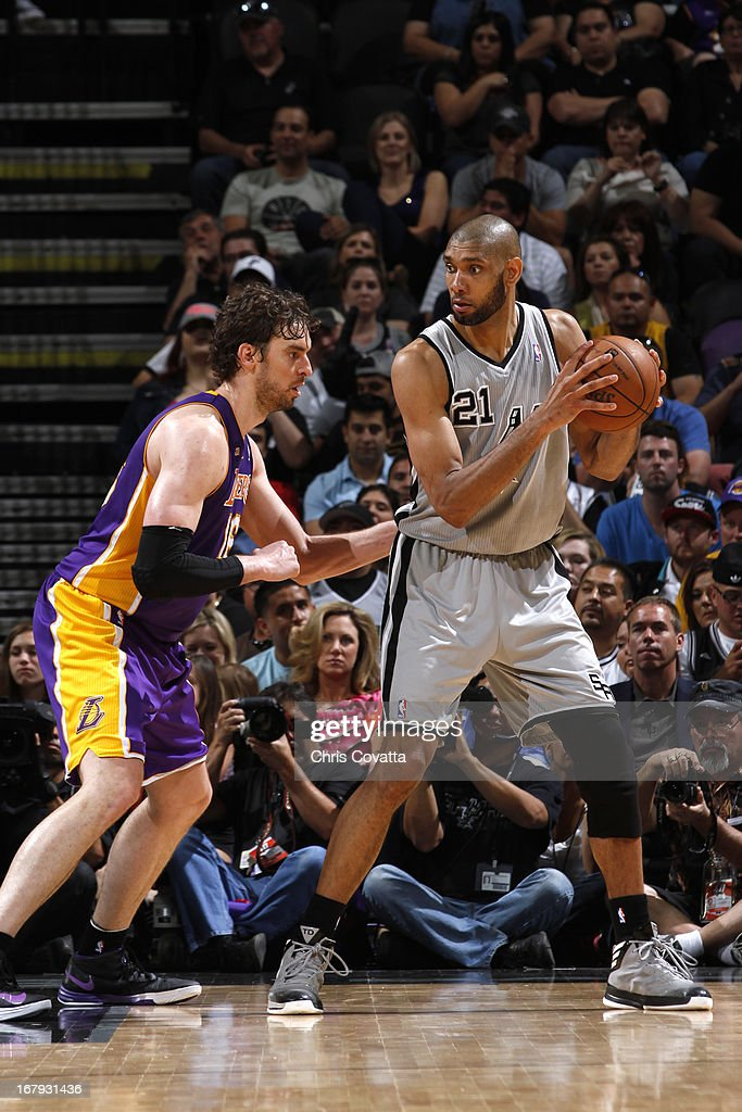 Tim Duncan #21 of the San Antonio Spurs looks to pass the ball against the Los Angeles Lakers in Game One of the 2013 NBA Playoffs at the AT&T Center on April 21, 2013 in San Antonio, Texas.