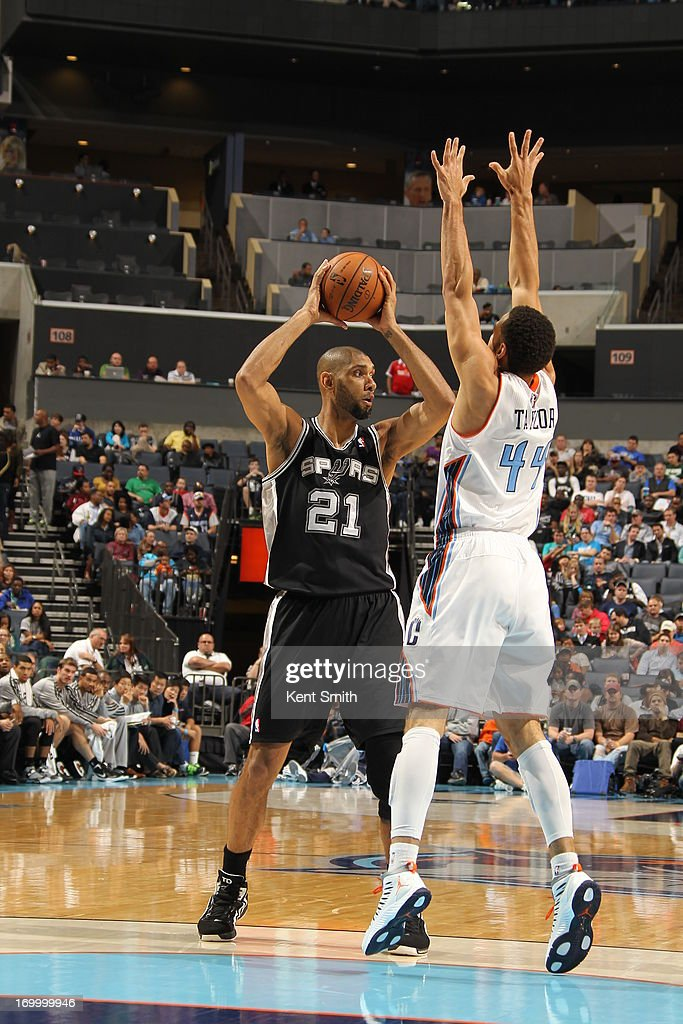 Tim Duncan #21 of the San Antonio Spurs looks to pass the ball against the Charlotte Bobcats at the Time Warner Cable Arena on December 8, 2012 in Charlotte, North Carolina.