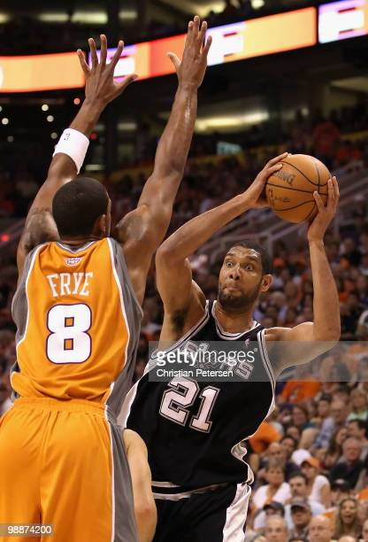 Tim Duncan of the San Antonio Spurs looks to pass the ball around Channing Frye of the Phoenix Suns during Game Two of the Western Conference...