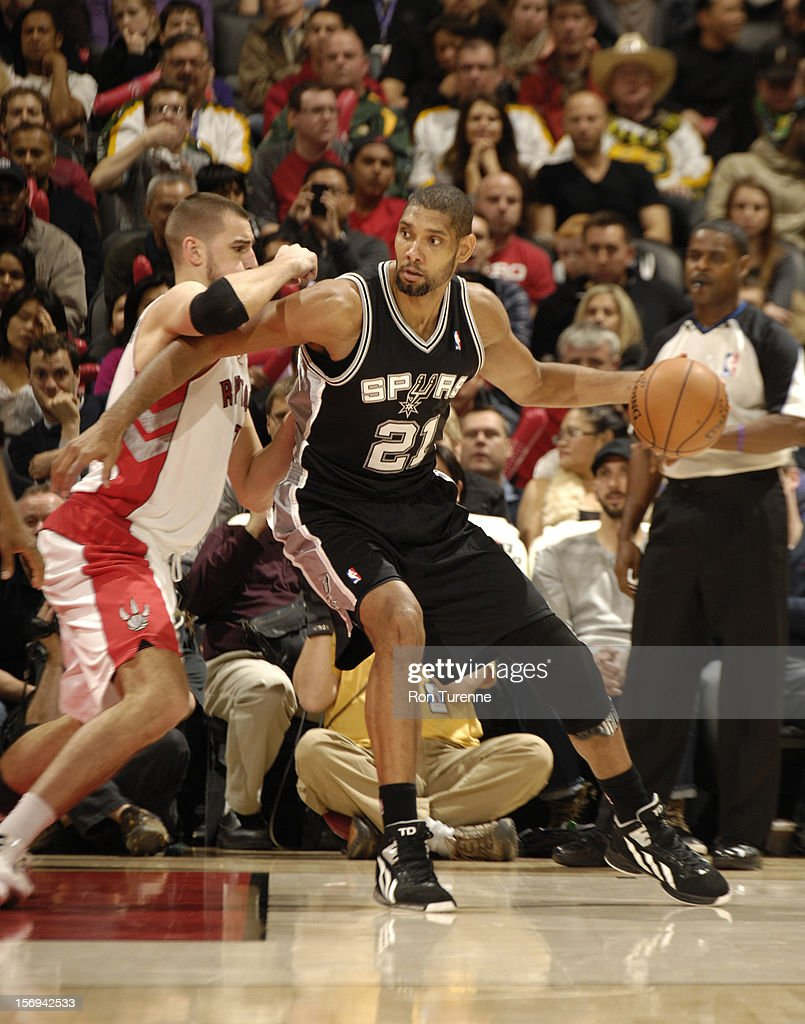 <a gi-track='captionPersonalityLinkClicked' href=/galleries/search?phrase=Tim+Duncan&family=editorial&specificpeople=201467 ng-click='$event.stopPropagation()'>Tim Duncan</a> #21 of the San Antonio Spurs looks to pass the ball vs the Toronto Raptors during the game on November 25, 2012 at the Air Canada Centre in Toronto, Ontario, Canada.