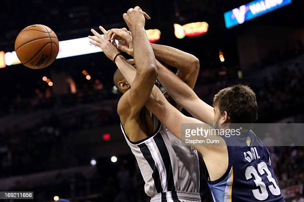 Tim Duncan of the San Antonio Spurs loses the ball as he draws contact from Marc Gasol of the Memphis Grizzlies in the second half during Game Two of...