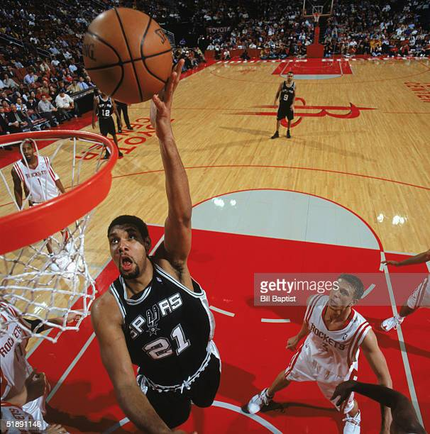 Tim Duncan of the San Antonio Spurs makes a layup against the Houston Rockets at Toyota Center on December 9 2004 in Houston Rockets The Rockets won...