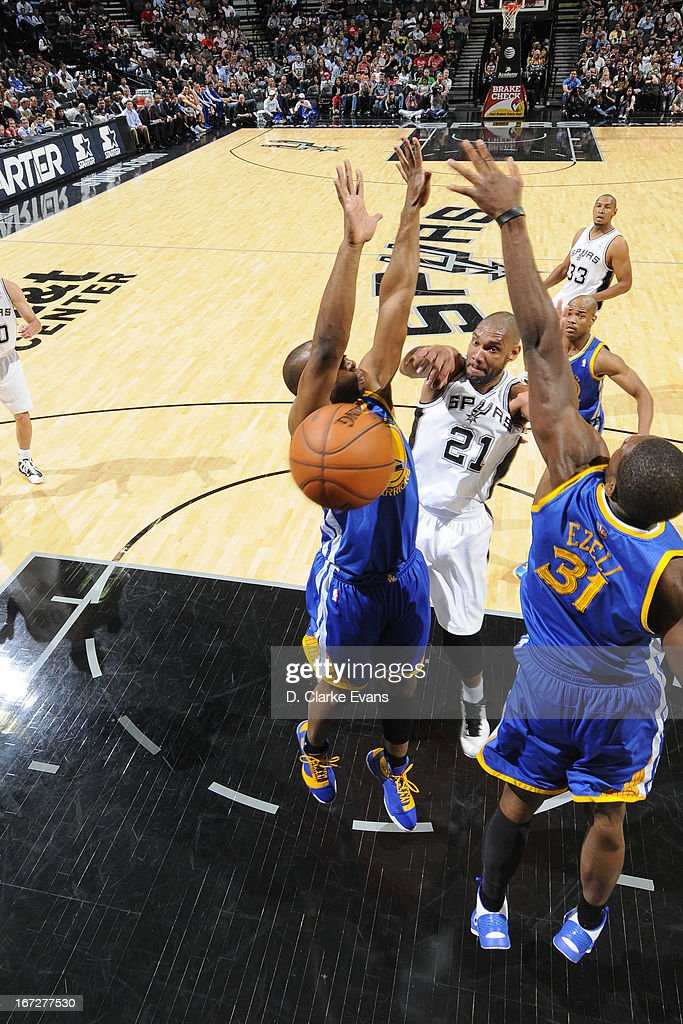 Tim Duncan #21 of the San Antonio Spurs passes the ball against the Golden State Warriors on March 20, 2013 at the AT&T Center in San Antonio, Texas.