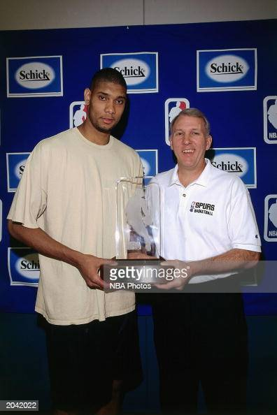 Tim Duncan of the San Antonio Spurs poses for a portrait with Gregg Popovich during the Rookie of the Year press conference on April 27 1998 in San...