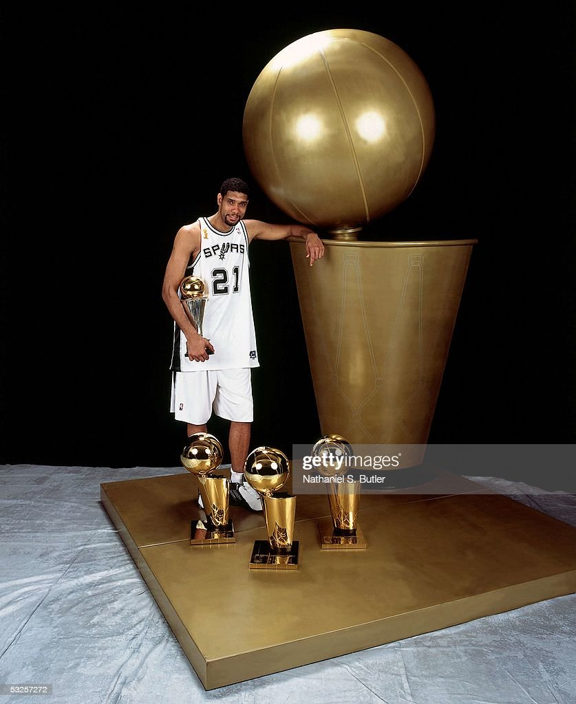 <a gi-track='captionPersonalityLinkClicked' href=/galleries/search?phrase=Tim+Duncan&family=editorial&specificpeople=201467 ng-click='$event.stopPropagation()'>Tim Duncan</a> #21 of the San Antonio Spurs poses with his championship trophies after winning Game Seven of the 2005 NBA Finals June 23, 2005 at the SBC Center in San Antonio, Texas. The Spurs defeated the Pistons 81-74.
