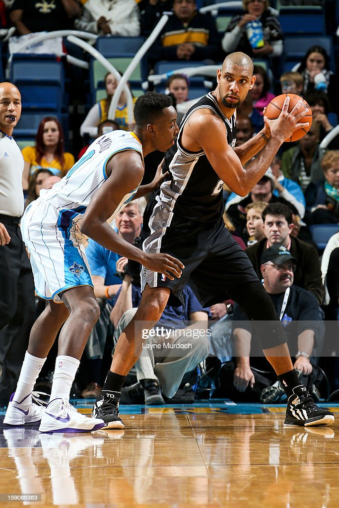 Tim Duncan #21 of the San Antonio Spurs posts up against Al-Farouq Aminu #0 of the New Orleans Hornets on January 7, 2013 at the New Orleans Arena in New Orleans, Louisiana.