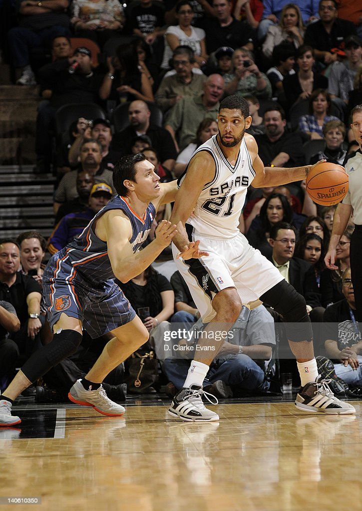 <a gi-track='captionPersonalityLinkClicked' href=/galleries/search?phrase=Tim+Duncan&family=editorial&specificpeople=201467 ng-click='$event.stopPropagation()'>Tim Duncan</a> #21 of the San Antonio Spurs posts up against <a gi-track='captionPersonalityLinkClicked' href=/galleries/search?phrase=Eduardo+Najera&family=editorial&specificpeople=202652 ng-click='$event.stopPropagation()'>Eduardo Najera</a> #21 of the Charlotte Bobcats during the game at the AT&T Center on March 2, 2012 in San Antonio, Texas.
