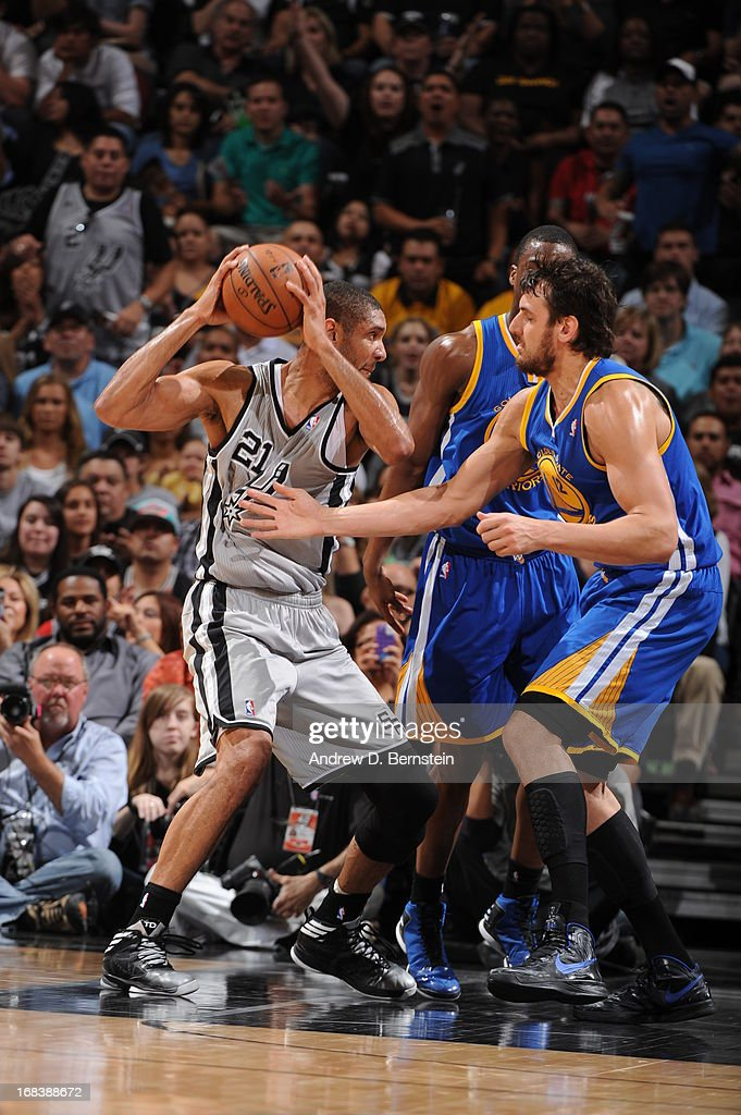 <a gi-track='captionPersonalityLinkClicked' href=/galleries/search?phrase=Tim+Duncan&family=editorial&specificpeople=201467 ng-click='$event.stopPropagation()'>Tim Duncan</a> #21 of the San Antonio Spurs protects the ball against <a gi-track='captionPersonalityLinkClicked' href=/galleries/search?phrase=Andrew+Bogut&family=editorial&specificpeople=207105 ng-click='$event.stopPropagation()'>Andrew Bogut</a> #12 of the Golden State Warriors in Game Two of the Western Conference Semifinals during the 2013 NBA Playoffs on May 8, 2013 at the AT&T Center in San Antonio, Texas.