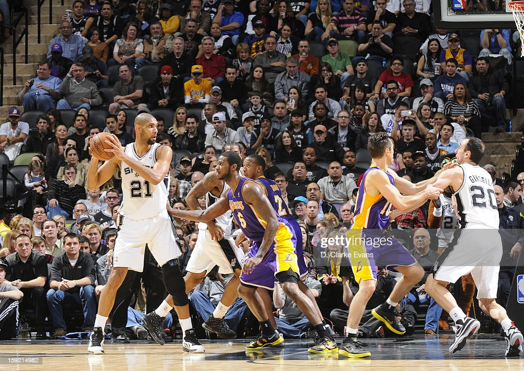 Tim Duncan #21 of the San Antonio Spurs protects the ball from Earl Clark #6 of the Los Angeles Lakers during the game between the Los Angeles Lakers and the San Antonio Spurs on January 9, 2013 at the AT&T Center in San Antonio, Texas.