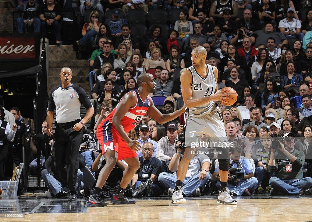 Tim Duncan #21 of the San Antonio Spurs protects the ball from Emeka Okafor #50 of the Washington Wizards during the game between the Washington Wizards and the San Antonio Spurs on February 2, 2013 at the AT&T Center in San Antonio, Texas.