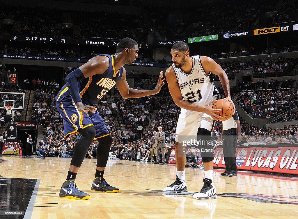 <a gi-track='captionPersonalityLinkClicked' href=/galleries/search?phrase=Tim+Duncan&family=editorial&specificpeople=201467 ng-click='$event.stopPropagation()'>Tim Duncan</a> #21 of the San Antonio Spurs protects the ball from <a gi-track='captionPersonalityLinkClicked' href=/galleries/search?phrase=Roy+Hibbert&family=editorial&specificpeople=725128 ng-click='$event.stopPropagation()'>Roy Hibbert</a> #55 of the Indiana Pacers during the game between the Indiana Pacers and the San Antonio Spurs on November 5, 2012 at the AT&T Center in San Antonio, Texas.
