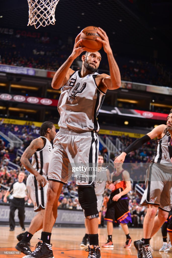 <a gi-track='captionPersonalityLinkClicked' href=/galleries/search?phrase=Tim+Duncan&family=editorial&specificpeople=201467 ng-click='$event.stopPropagation()'>Tim Duncan</a> #21 of the San Antonio Spurs pulls down a rebound against the Phoenix Suns on February 24, 2013 at U.S. Airways Center in Phoenix, Arizona.