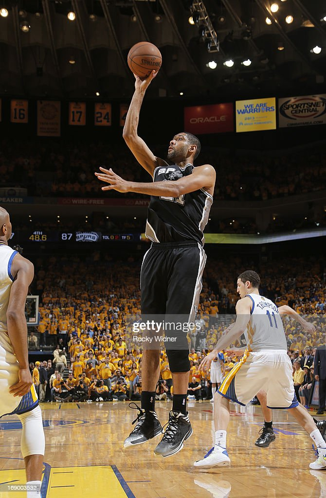 Tim Duncan #21 of the San Antonio Spurs puts up a shot against the Golden State Warriors in Game Four of the Western Conference Semifinals during the 2013 NBA Playoffs on May 12, 2013 at Oracle Arena in Oakland, California.