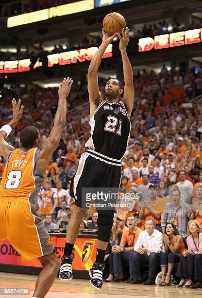 Tim Duncan of the San Antonio Spurs puts up a shot over Channing Frye of the Phoenix Suns during Game Two of the Western Conference Semifinals of the...