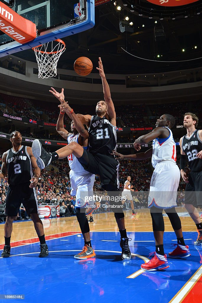 Tim Duncan #21 of the San Antonio Spurs reaches for the rebound against Thaddeus Young #21 of the Philadelphia 76ers during the game at the Wells Fargo Center on January 21, 2013 in Philadelphia, Pennsylvania.