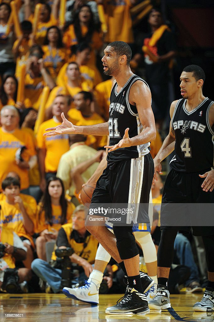 Tim Duncan #21 of the San Antonio Spurs reacts after a play against the Golden State Warriors in Game Four of the Western Conference Semifinals during the 2013 NBA Playoffs on May 12, 2013 at the Oracle Arena in Oakland, California.