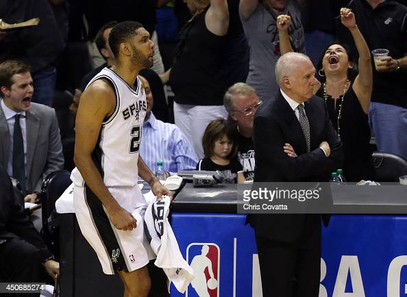 Tim Duncan of the San Antonio Spurs reacts on the bench against the Miami Heat during Game Five of the 2014 NBA Finals at the ATT Center on June 15...