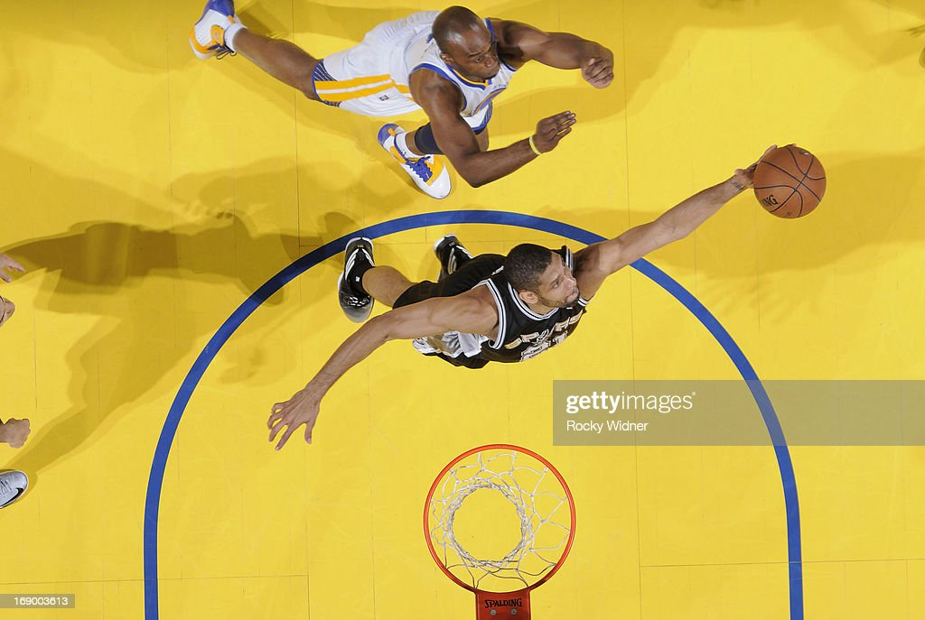 <a gi-track='captionPersonalityLinkClicked' href=/galleries/search?phrase=Tim+Duncan&family=editorial&specificpeople=201467 ng-click='$event.stopPropagation()'>Tim Duncan</a> #21 of the San Antonio Spurs rebounds against <a gi-track='captionPersonalityLinkClicked' href=/galleries/search?phrase=Carl+Landry&family=editorial&specificpeople=4111952 ng-click='$event.stopPropagation()'>Carl Landry</a> #7 of the Golden State Warriors in Game Four of the Western Conference Semifinals during the 2013 NBA Playoffs on May 12, 2013 at Oracle Arena in Oakland, California.