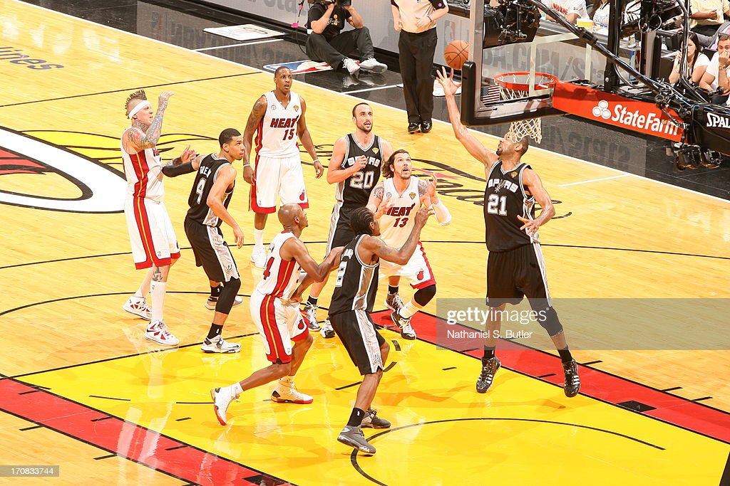 Tim Duncan #21 of the San Antonio Spurs rebounds the ball while playing against the Miami Heat in Game Six of the 2013 NBA Finals on June 18, 2013 at American Airlines Arena in Miami, Florida.