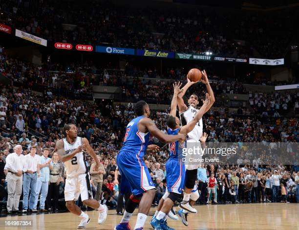 Tim Duncan of the San Antonio Spurs sends a winning shot in during the game between the Los Angeles Clippers and the San Antonio Spurs on March 29...