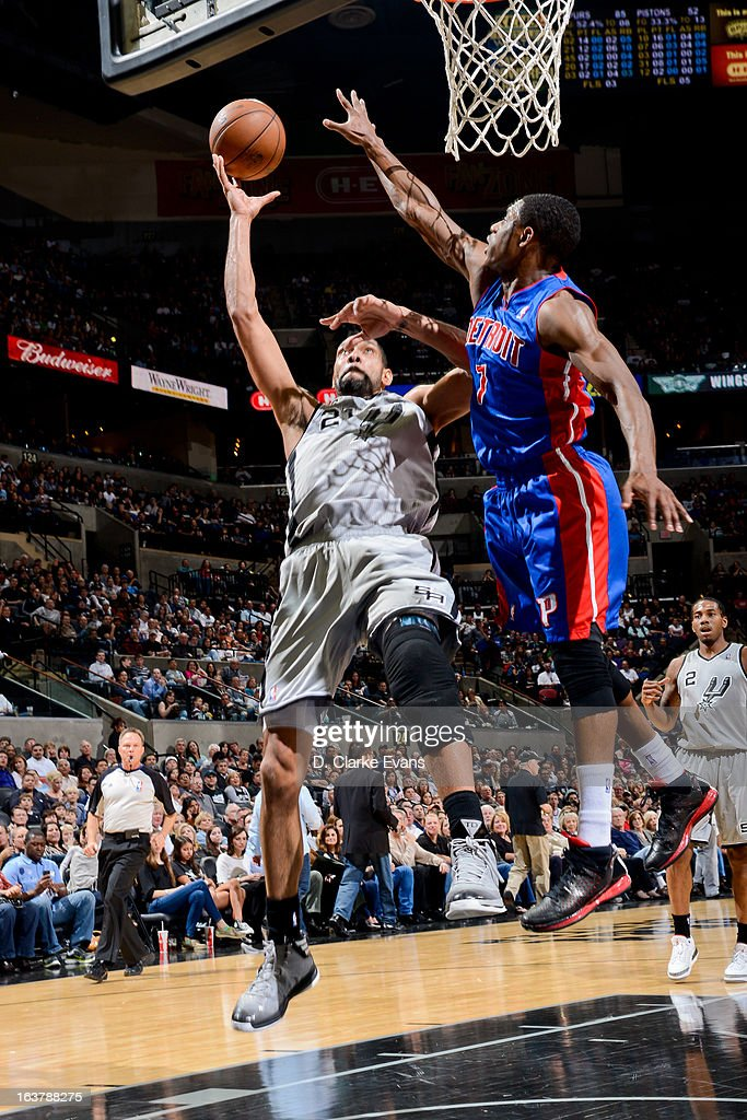 Tim Duncan #21 of the San Antonio Spurs shoots a layup against Brandon Knight #7 of the Detroit Pistons on March 3, 2013 at the AT&T Center in San Antonio, Texas.