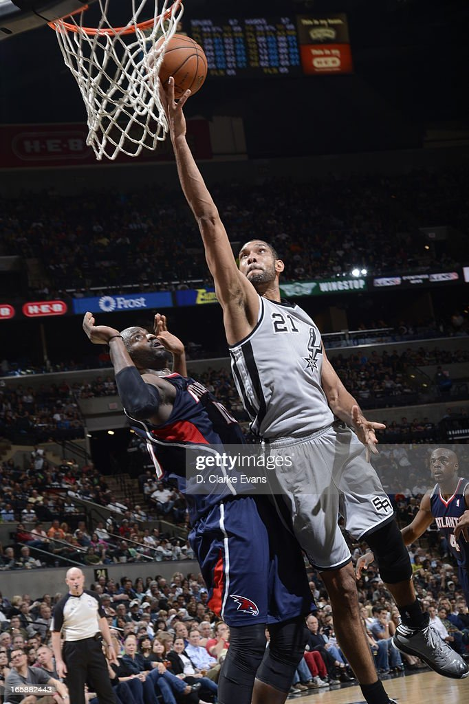 Tim Duncan #21 of the San Antonio Spurs shoots a layup against Johan Petro #10 of the Atlanta Hawks on April 6, 2013 at the AT&T Center in San Antonio, Texas.