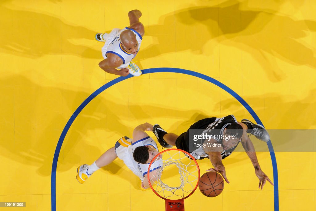 Tim Duncan #21 of the San Antonio Spurs shoots a layup against Klay Thompson #11 of the Golden State Warriors in Game Six of the Western Conference Semifinals during the 2013 NBA Playoffs on May 16, 2013 at Oracle Arena in Oakland, California.