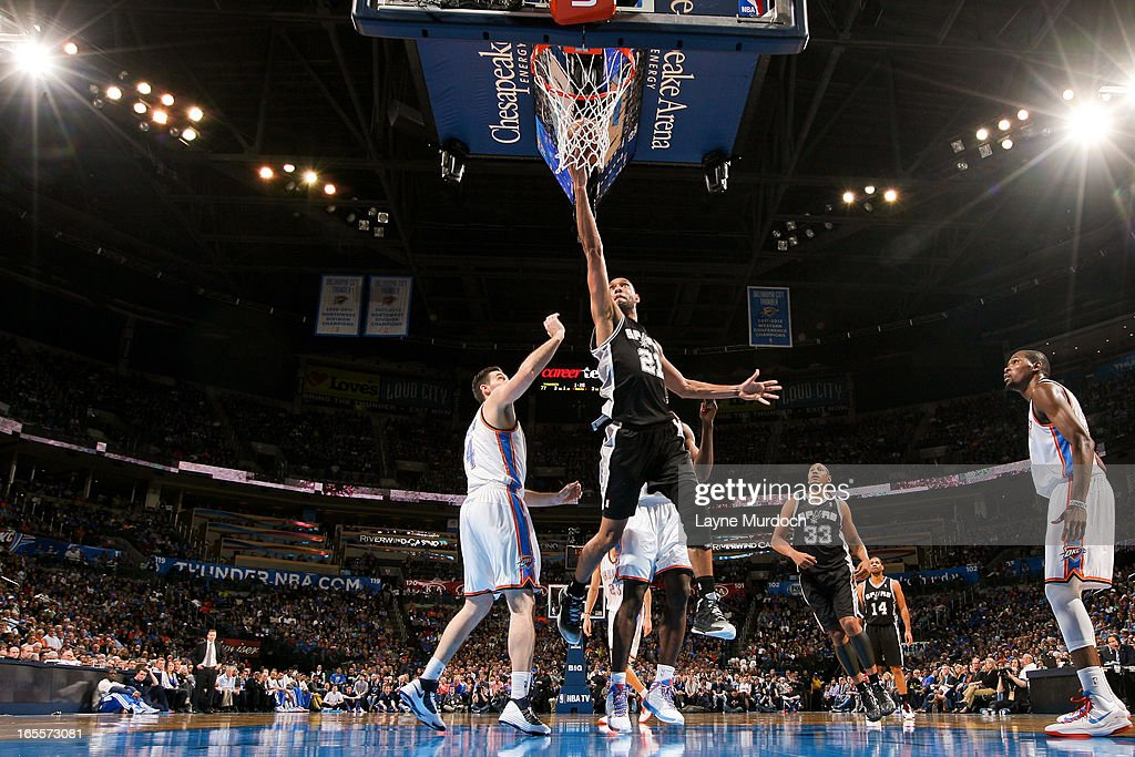 Tim Duncan #21 of the San Antonio Spurs shoots a layup against the Oklahoma City Thunder on April 4, 2013 at the Chesapeake Energy Arena in Oklahoma City, Oklahoma.