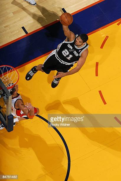 Tim Duncan of the San Antonio Spurs shoots a layup during the game against the Golden State Warriors at Oracle Arena on February 2 2009 in Oakland...