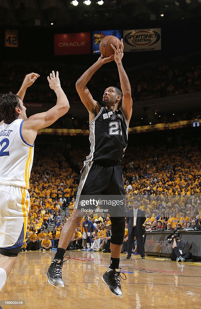Tim Duncan #21 of the San Antonio Spurs shoots against Andrew Bogut #12 of the Golden State Warriors in Game Four of the Western Conference Semifinals during the 2013 NBA Playoffs on May 12, 2013 at Oracle Arena in Oakland, California.