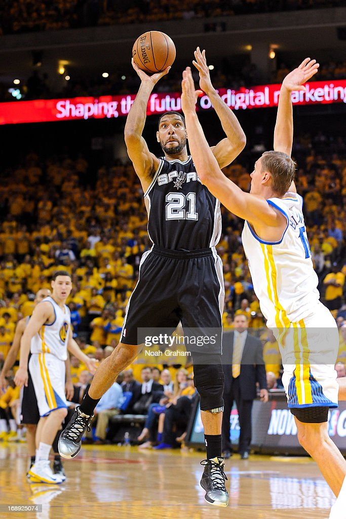 Tim Duncan #21 of the San Antonio Spurs shoots against Andris Biedrins #15 of the Golden State Warriors in Game Six of the Western Conference Semifinals during the 2013 NBA Playoffs on May 16, 2013 at Oracle Arena in Oakland, California.