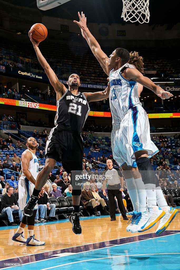 Tim Duncan #21 of the San Antonio Spurs shoots against Anthony Davis #23 of the New Orleans Hornets on January 7, 2013 at the New Orleans Arena in New Orleans, Louisiana.
