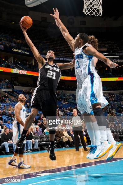 Tim Duncan of the San Antonio Spurs shoots against Anthony Davis of the New Orleans Hornets on January 7 2013 at the New Orleans Arena in New Orleans...
