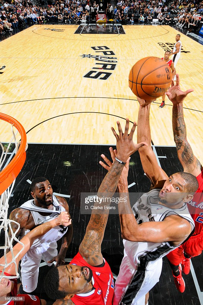 <a gi-track='captionPersonalityLinkClicked' href=/galleries/search?phrase=Tim+Duncan&family=editorial&specificpeople=201467 ng-click='$event.stopPropagation()'>Tim Duncan</a> #21 of the San Antonio Spurs shoots against <a gi-track='captionPersonalityLinkClicked' href=/galleries/search?phrase=DeAndre+Jordan&family=editorial&specificpeople=4665718 ng-click='$event.stopPropagation()'>DeAndre Jordan</a> #6 of the Los Angeles Clippers on November 19, 2012 at the AT&T Center in San Antonio, Texas.