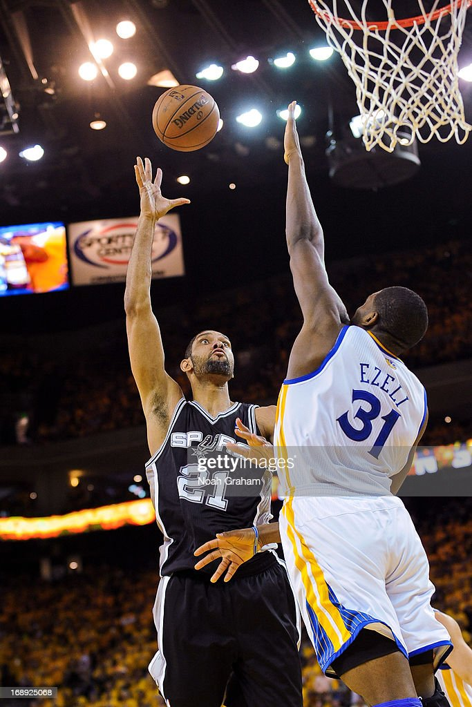 Tim Duncan #21 of the San Antonio Spurs shoots against Festus Ezeli #31 of the Golden State Warriors in Game Six of the Western Conference Semifinals during the 2013 NBA Playoffs on May 16, 2013 at Oracle Arena in Oakland, California.