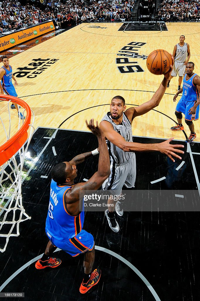 <a gi-track='captionPersonalityLinkClicked' href=/galleries/search?phrase=Tim+Duncan&family=editorial&specificpeople=201467 ng-click='$event.stopPropagation()'>Tim Duncan</a> #21 of the San Antonio Spurs shoots against <a gi-track='captionPersonalityLinkClicked' href=/galleries/search?phrase=Kendrick+Perkins&family=editorial&specificpeople=211461 ng-click='$event.stopPropagation()'>Kendrick Perkins</a> #5 of the Oklahoma City Thunder on November 1, 2012 at the AT&T Center in San Antonio, Texas.
