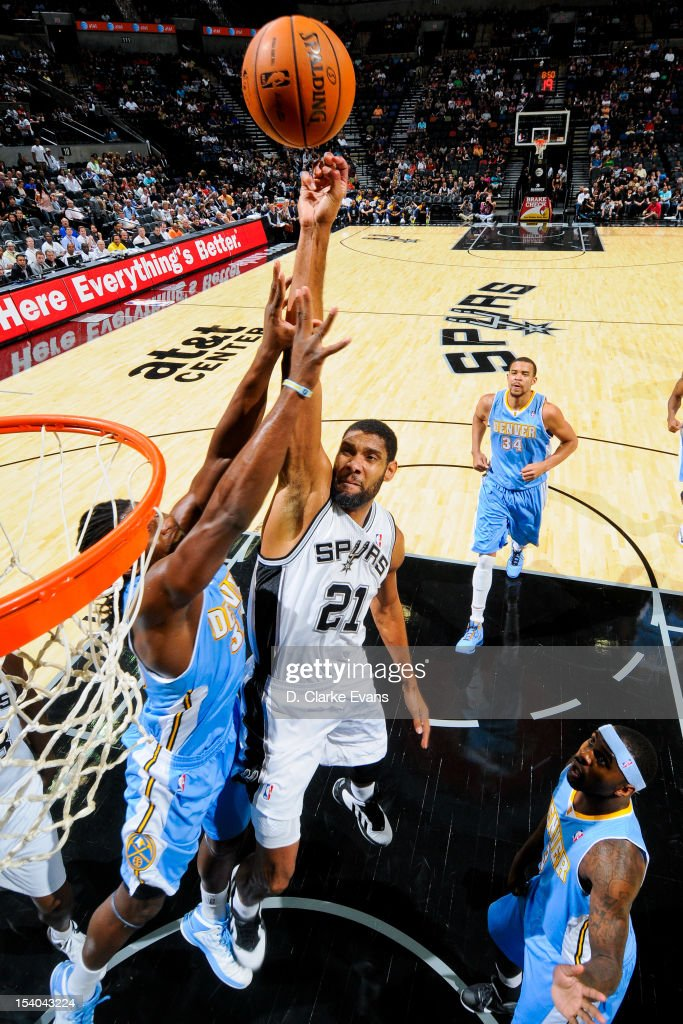 <a gi-track='captionPersonalityLinkClicked' href=/galleries/search?phrase=Tim+Duncan&family=editorial&specificpeople=201467 ng-click='$event.stopPropagation()'>Tim Duncan</a> #21 of the San Antonio Spurs shoots against <a gi-track='captionPersonalityLinkClicked' href=/galleries/search?phrase=Kenneth+Faried&family=editorial&specificpeople=5765135 ng-click='$event.stopPropagation()'>Kenneth Faried</a> #35 of the Denver Nuggets during a pre-season game on October 12, 2012 at the AT&T Center in San Antonio, Texas.