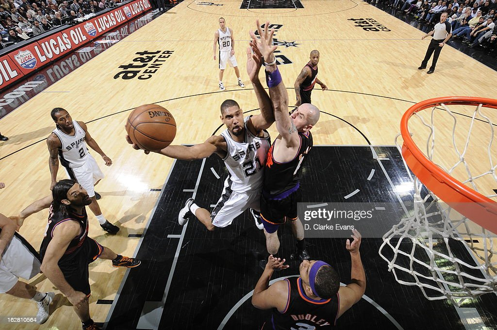 <a gi-track='captionPersonalityLinkClicked' href=/galleries/search?phrase=Tim+Duncan&family=editorial&specificpeople=201467 ng-click='$event.stopPropagation()'>Tim Duncan</a> #21 of the San Antonio Spurs shoots against <a gi-track='captionPersonalityLinkClicked' href=/galleries/search?phrase=Marcin+Gortat&family=editorial&specificpeople=589986 ng-click='$event.stopPropagation()'>Marcin Gortat</a> #4 of the Phoenix Suns on February 27, 2013 at the AT&T Center in San Antonio, Texas.