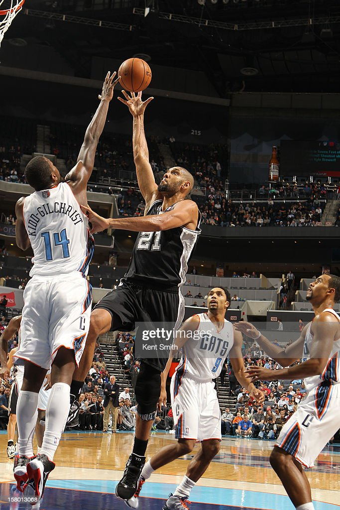 Tim Duncan #21 of the San Antonio Spurs shoots against Michael Kidd-Gilchrist #14 of the Charlotte Bobcats at the Time Warner Cable Arena on December 8, 2012 in Charlotte, North Carolina.