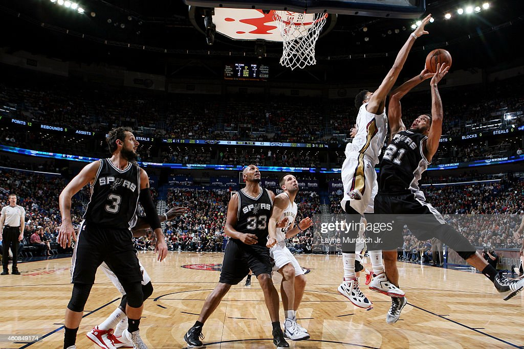 Tim Duncan #21 of the San Antonio Spurs shoots against the New Orleans Pelicans on December 26, 2014 at Smoothie King Center in New Orleans, Louisiana.