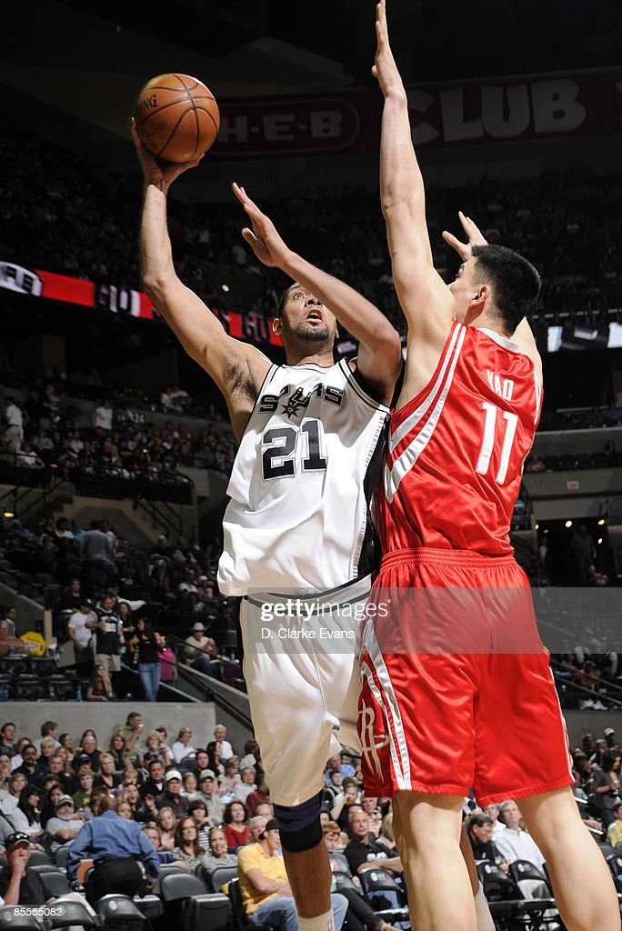 Tim Duncan #21 of the San Antonio Spurs shoots against Yao Ming #11 of the Houston Rockets on March 22, 2009 at the AT&T Center in San Antonio, Texas.