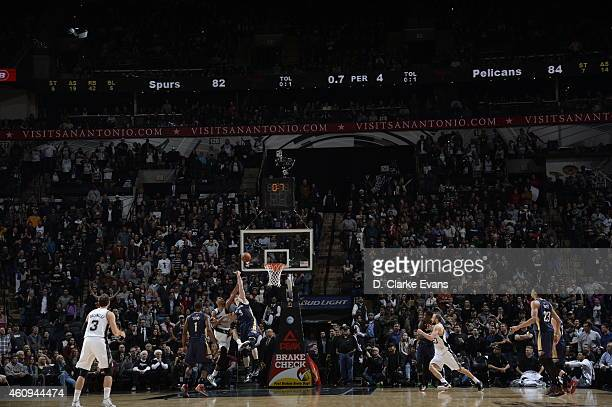 Tim Duncan of the San Antonio Spurs shoots and sends the game into overtime against Omer Asik of the New Orleans Pelicans on December 31 2014 at the...