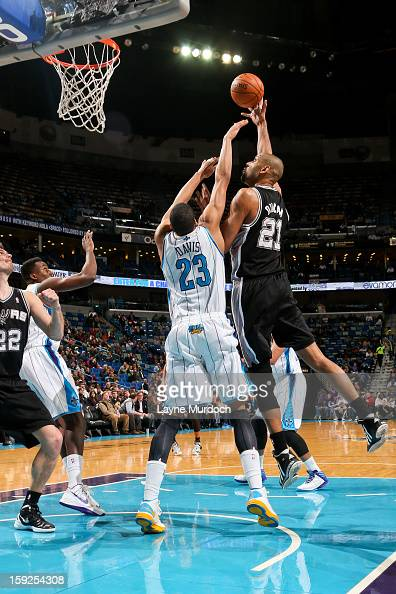Tim Duncan of the San Antonio Spurs shoots in the lane against Anthony Davis of the New Orleans Hornets on January 7 2013 at the New Orleans Arena in...