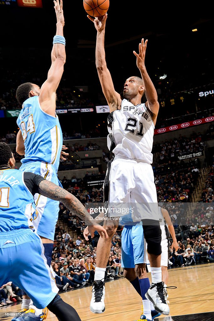<a gi-track='captionPersonalityLinkClicked' href=/galleries/search?phrase=Tim+Duncan&family=editorial&specificpeople=201467 ng-click='$event.stopPropagation()'>Tim Duncan</a> #21 of the San Antonio Spurs shoots in the lane against <a gi-track='captionPersonalityLinkClicked' href=/galleries/search?phrase=JaVale+McGee&family=editorial&specificpeople=4195625 ng-click='$event.stopPropagation()'>JaVale McGee</a> #34 of the Denver Nuggets on March 27, 2013 at the AT&T Center in San Antonio, Texas.