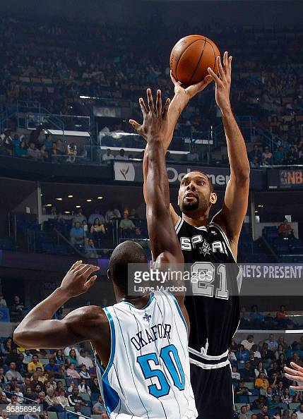 Tim Duncan of the San Antonio Spurs shoots over Emeka Okafor of the New Orleans Hornets on January 18 2010 at the New Orleans Arena in New Orleans...
