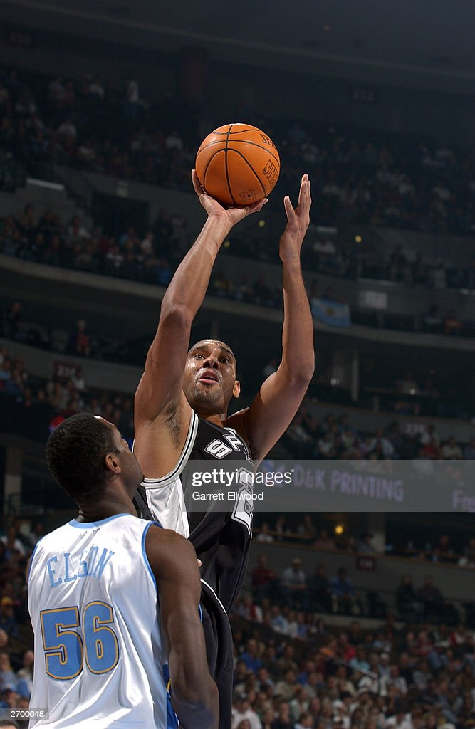 <a gi-track='captionPersonalityLinkClicked' href=/galleries/search?phrase=Tim+Duncan&family=editorial&specificpeople=201467 ng-click='$event.stopPropagation()'>Tim Duncan</a> #21 of the San Antonio Spurs shoots over Francisco Elson #56 of the Denver Nuggets at the Pepsi Center on October 29, 2003 in Denver, Colorado. The Nuggets won 80-72.