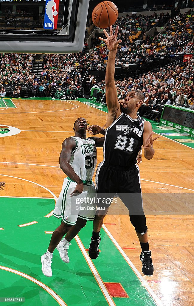 Tim Duncan #21 of the San Antonio Spurs shoots the ball against Brandon Bass #30 of the Boston Celtics on November 21, 2012 at the TD Garden in Boston, Massachusetts.